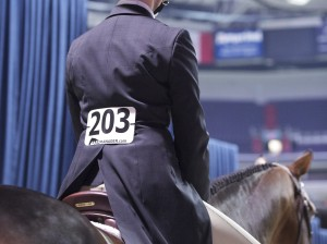 Courtney Carey in her shad belly ready to enter the ring aboard horse Love Notes.  Photo Credit: