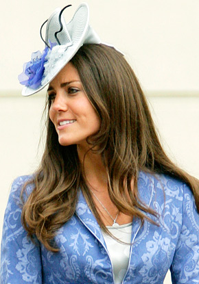 Kate Middleton pictured in a white and periwinkle fascinator. Photo Credit: US Weekly