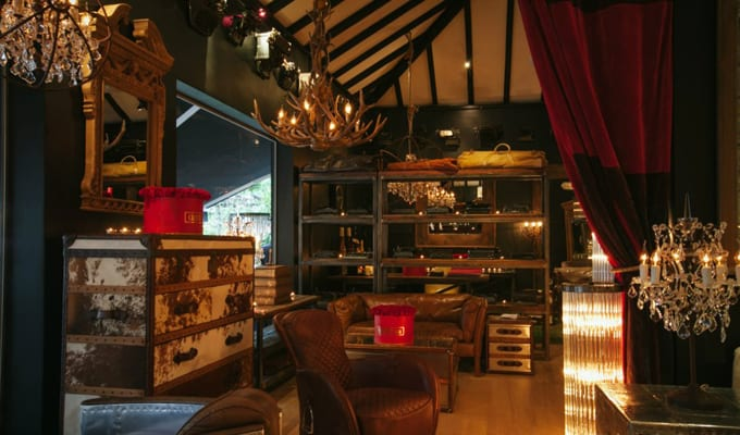 Dark Wood Beams, Velvet Royal Red Curtains With Hunter Green Walls And  Antler Chandeliers Showcase A Tasteful Masculine Equestrian Style.